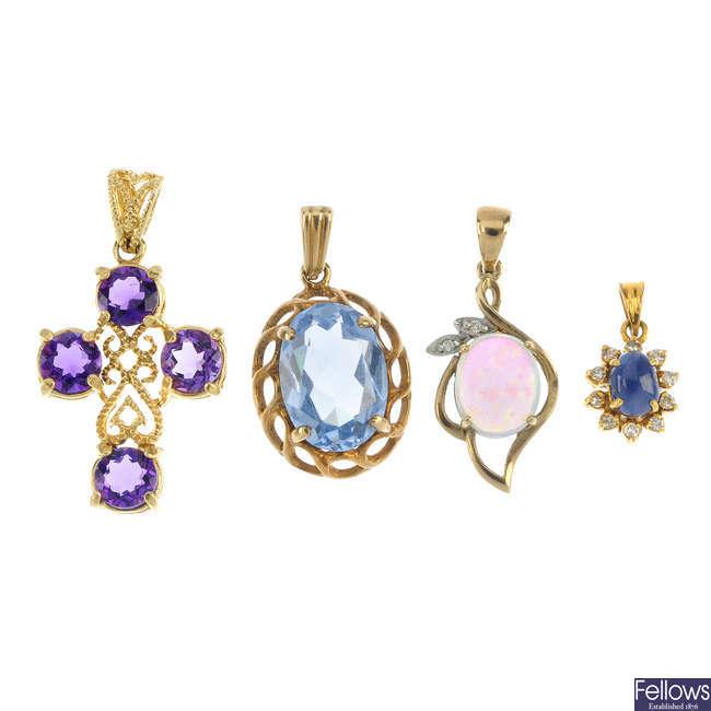 A selection of four gem-set pendants.