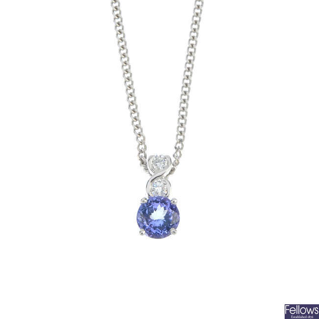 An 18ct gold tanzanite and diamond pendant.
