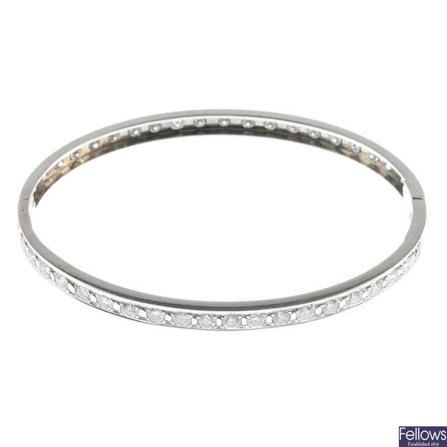 A 14ct gold diamond hinged bangle.