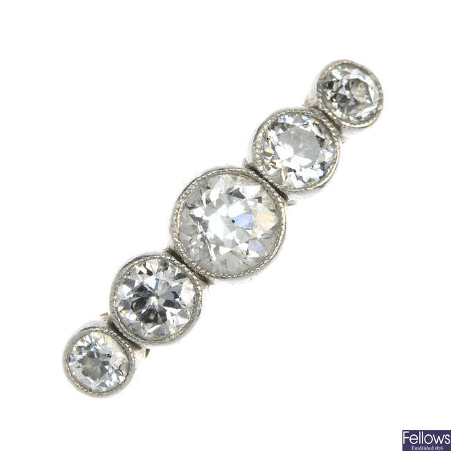 A mid 20th century gold diamond five-stone ring.