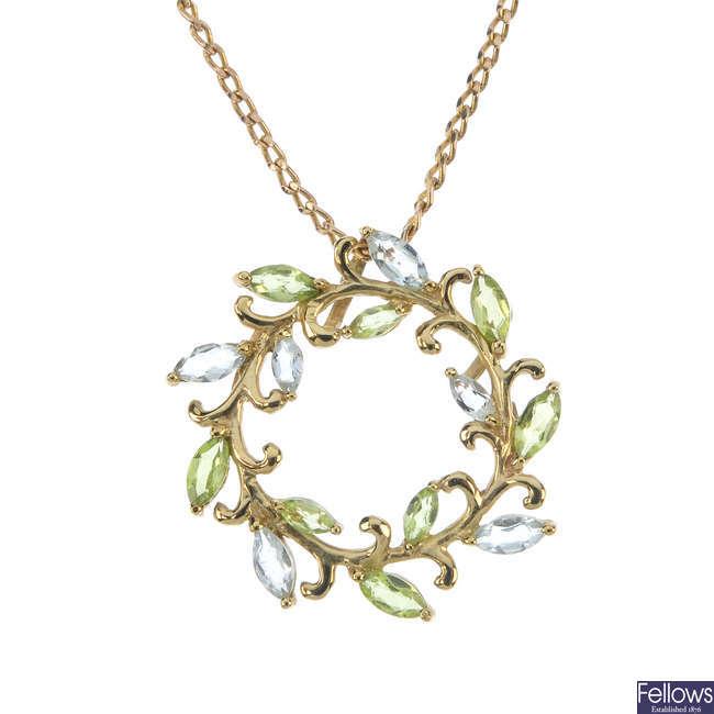 A 9ct gold aquamarine and peridot wreath pendant.