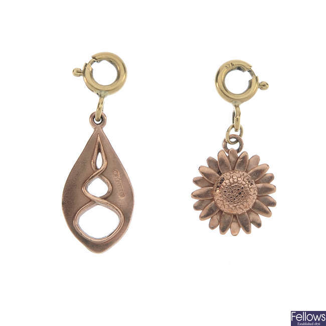 CLOGAU - two 9ct gold charms.