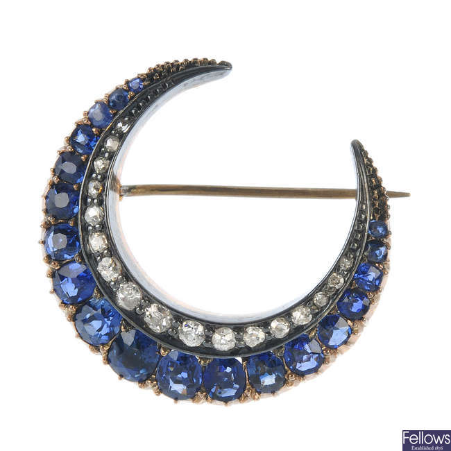 A late 19th century century silver and 9ct gold sapphire and diamond crescent brooch.