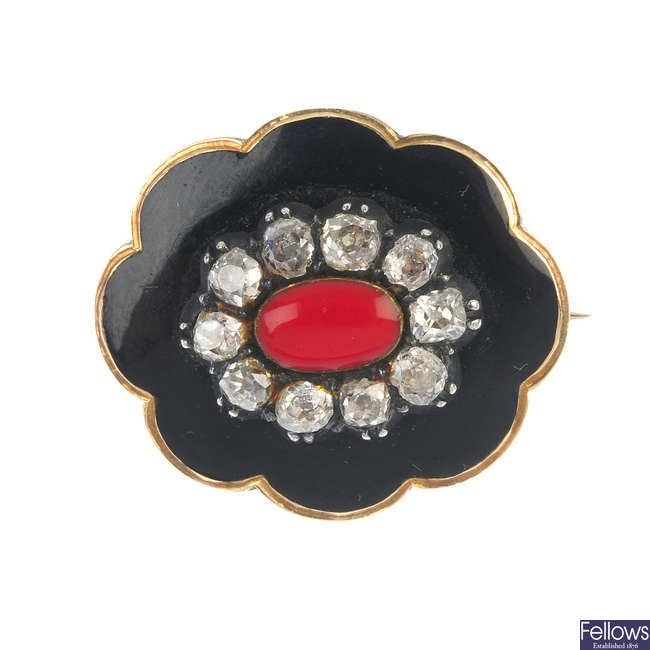 An early Victorian diamond and enamel mourning brooch.