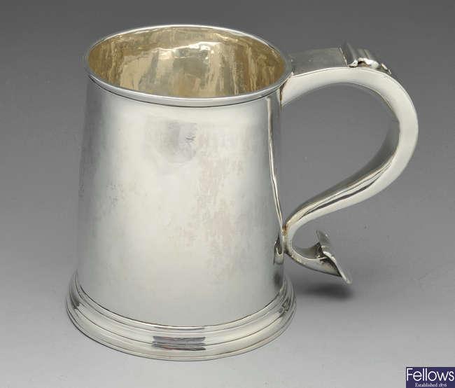 A Queen Anne Britannia silver mug.