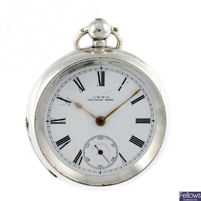 A silver open face pocket watch by Waltham.