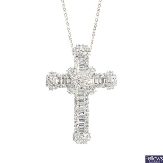 An 18ct gold diamond cross pendant.