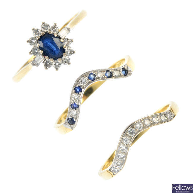 A set of three 18ct gold sapphire and diamond rings.