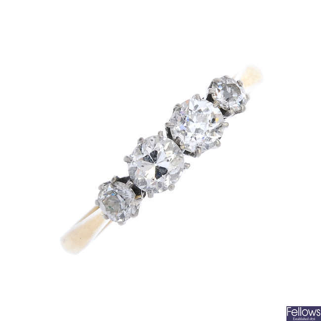 A mid 20th century 18ct gold and platinum diamond four-stone ring.