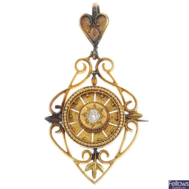 An early 20th century 16ct gold diamond pendant.