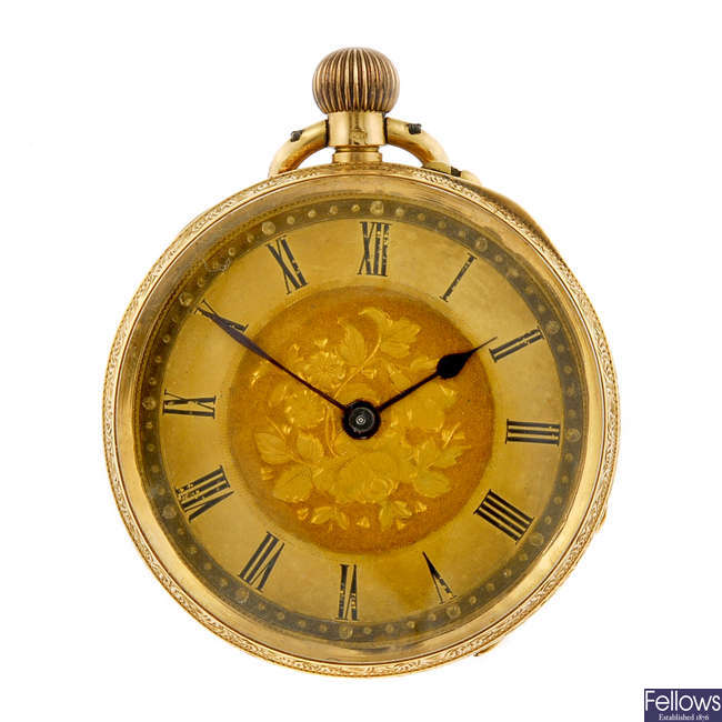 A yellow metal open face pocket watch.
