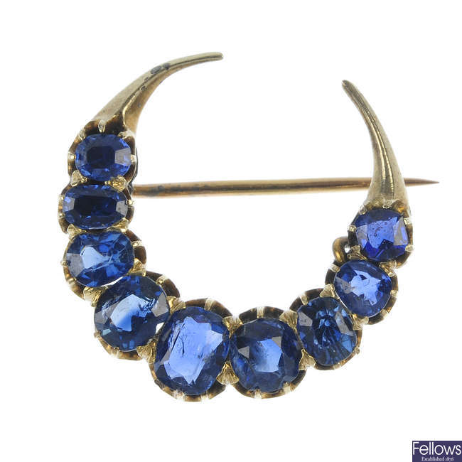 An early 20th century sapphire crescent brooch.
