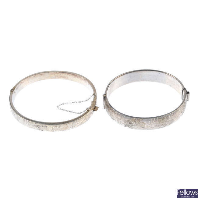 A selection of silver and white metal hinged bangles.