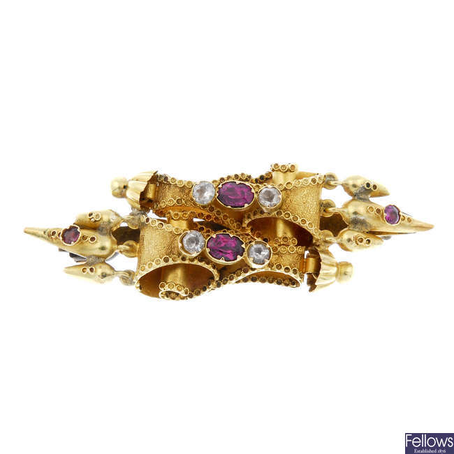 A late 19th century 18ct gold garnet and gem-set brooch.