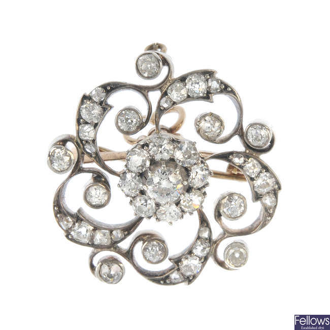 A late 19th century silver and 9ct gold diamond cluster brooch.