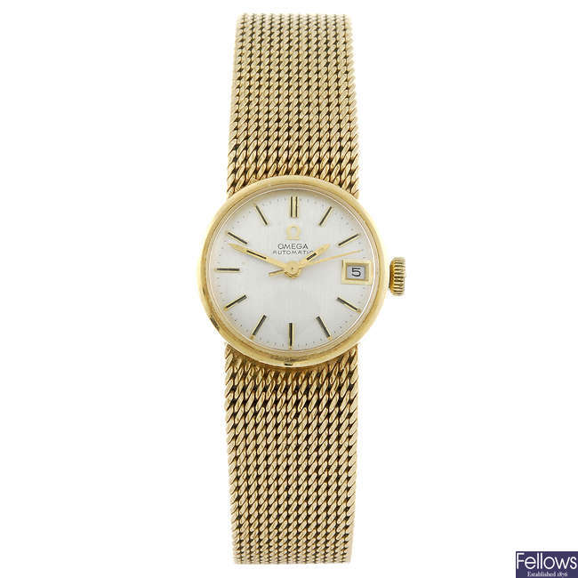 OMEGA - a lady's 9ct gold bracelet watch.
