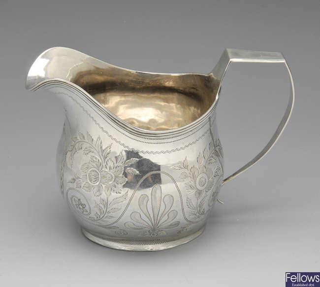 A George IV silver cream jug.