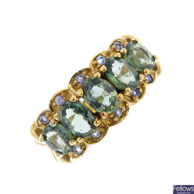 A 9ct gold sapphire and tanzanite three-row ring.