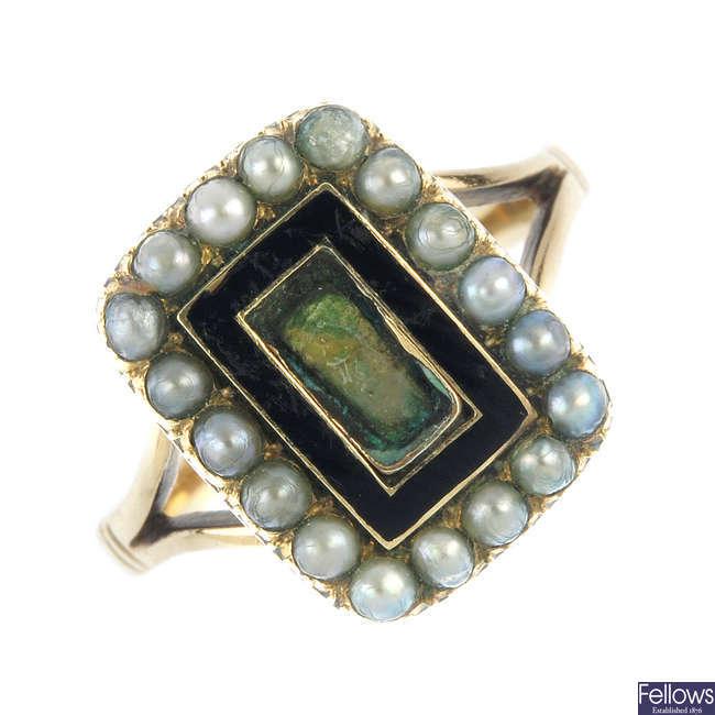 A split pearl and enamel memorial ring.