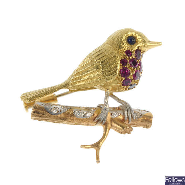 An 18ct gold diamond, ruby and sapphire robin brooch.