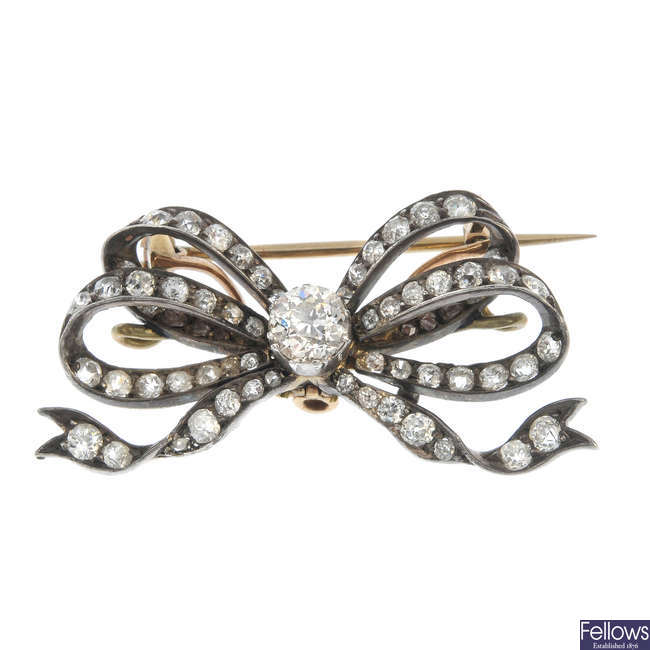 A late 19th century silver and 9ct gold diamond bow brooch.