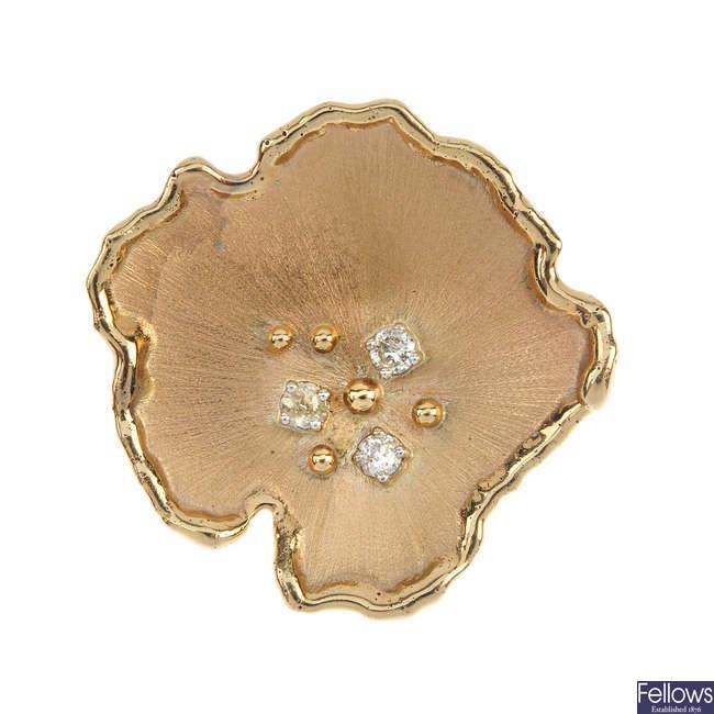 A diamond abstract flower brooch.