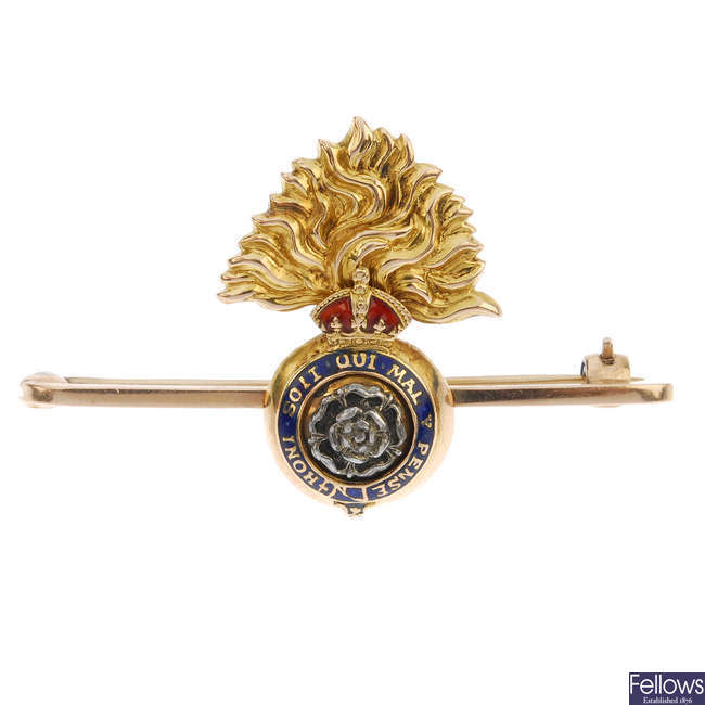 A mid 20th century enamel Royal Fusiliers bar brooch.