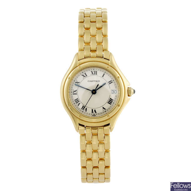 CARTIER - a yellow metal Cougar bracelet watch.
