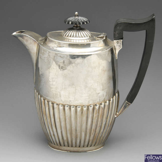A 1920's silver hot water pot.