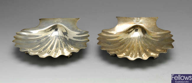 A pair of George III silver butter shells.