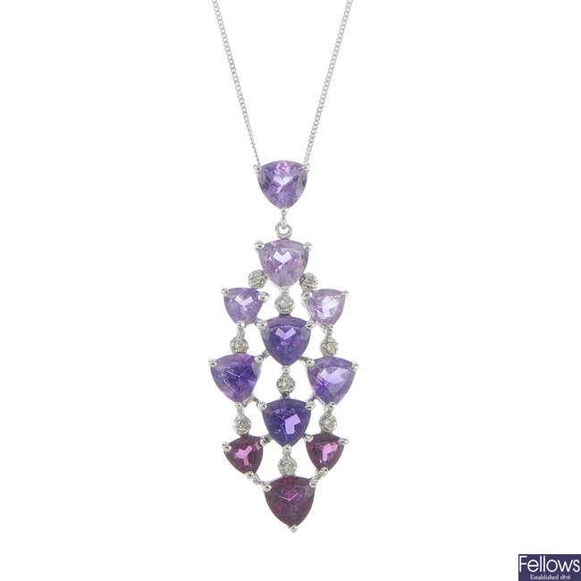 An amethyst, garnet and diamond pendant.