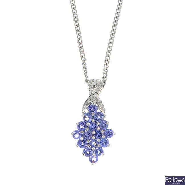 A 14ct gold tanzanite and diamond pendant.