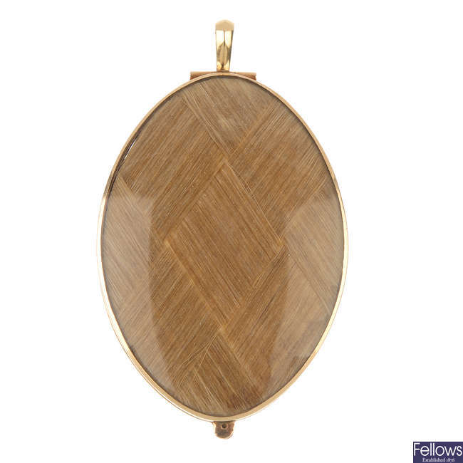 A late 19th century gold mourning pendant