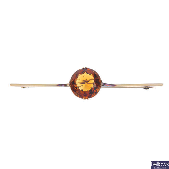 An early 20th century 15ct gold citrine bar brooch.