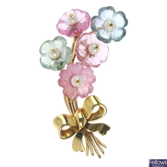 An 18ct gold gem-set floral brooch.