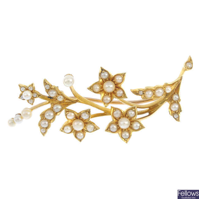 An early 20th century 15ct gold split-pearl and cultured pearl brooch.