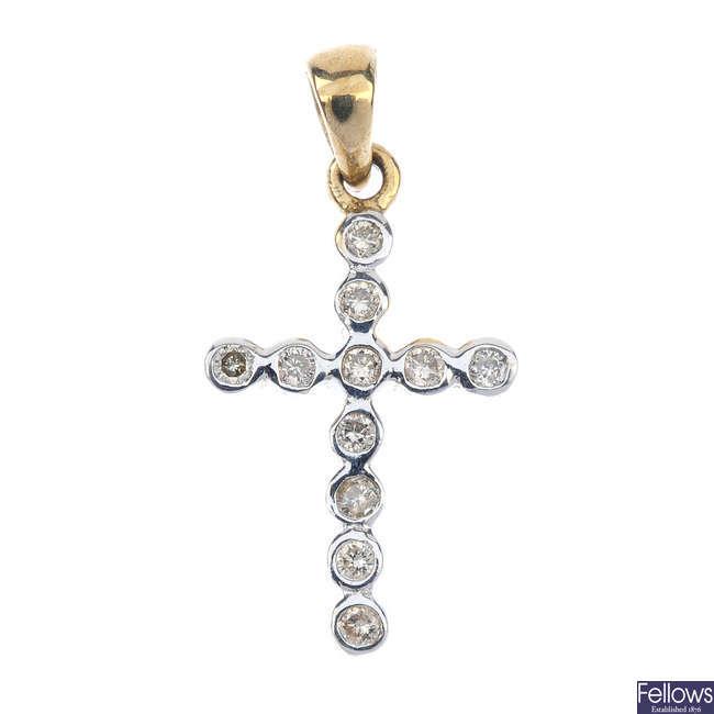 A pair of diamond ear studs and a diamond cross pendant.