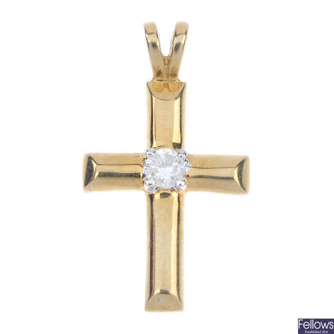 A 9ct gold diamond cross pendant.