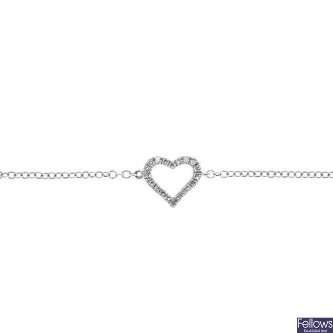 A 9ct gold diamond heart bracelet.