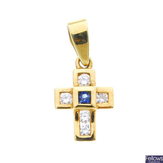 An 18ct gold sapphire and diamond cross pendant.