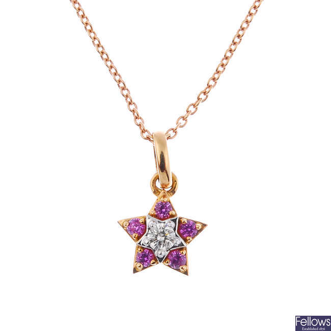 A diamond and sapphire star pendant.