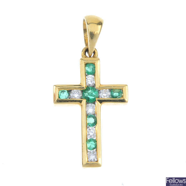 An 18ct gold emerald and diamond cross pendant.