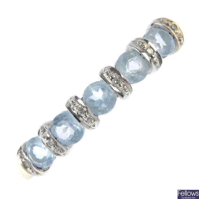 A 9ct gold aquamarine and diamond half-circle eternity ring.