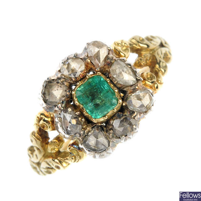 A mid 19th century silver and 15ct gold foil-back emerald and diamond cluster ring.