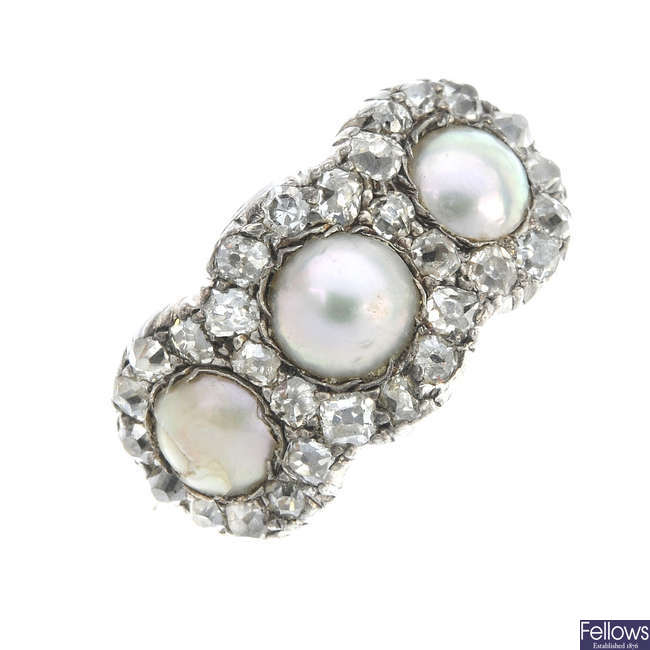 A late 19th century gold and silver split pearl and diamond triple cluster ring.