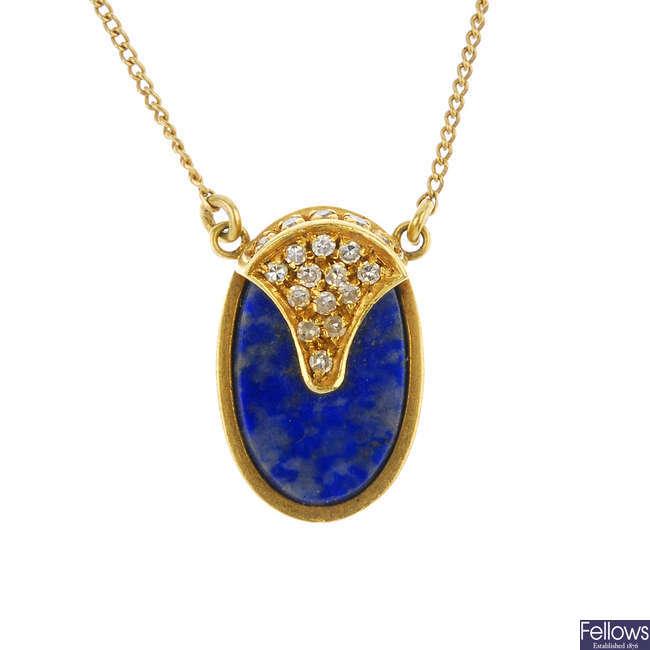 A 1970s 18ct gold diamond and lapis lazuli pendant.