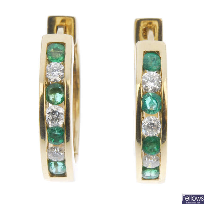 A pair of emerald and diamond ear hoops.