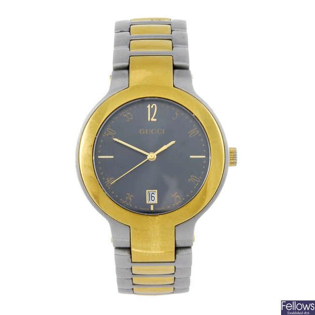 GUCCI - a gentleman's bi-colour 8900M bracelet watch.