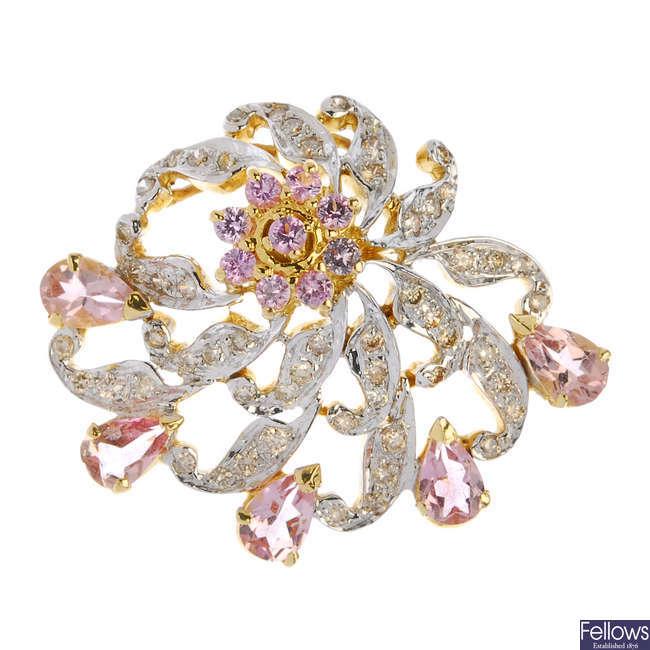 A sapphire and diamond pendant and ear stud set.