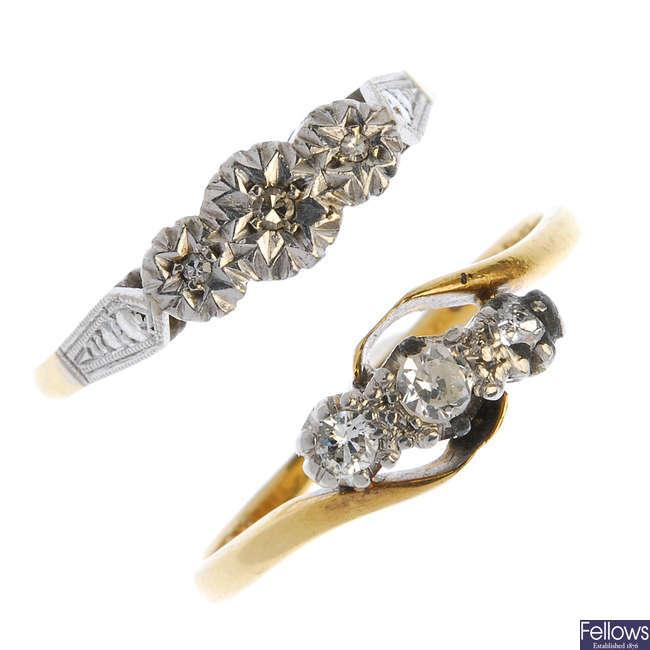 Two mid 20th century platinum and 18ct gold diamond three-stone rings.